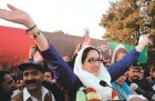 Benazir, alive and exuberant, as she arrives at the rally