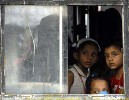 Who are terrorists? Children watch a condolence meeting from their school-bus in Mumbai
