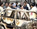 PM Manmohan Singh, Sonia Gandhi and Assam CM Tarun Gogoi at a blast site