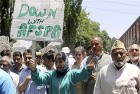 PDP President Mehbooba Mufti and other party leaders shout slogans against the government during a protest in Srinagar