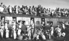 Train to Pakistan, overcrowded with fleeing Muslim refugees, near New Delhi on September 19, 1947