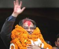 Prachanda greets the public after the Maoist victory became certain