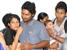 Home: Sangakkara with wife Yeheli; Dilshan with his baby son