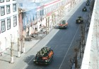 Chinese soldiers patrol the streets of Lhasa in armoured personnel carriers after a Tibetan protest to commemorate the 1959 uprising turned violent